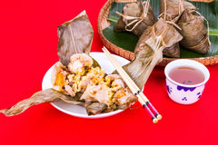 Steamed Chinese rice dumpling or zongzi served with oriental tea Royalty Free Stock Images