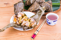 Steamed Chinese rice dumpling or zongzi served with oriental tea Royalty Free Stock Photo