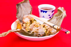 Steamed Chinese rice dumpling or zongzi served with oriental tea Stock Image