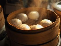 Steamed chinese stuff bun in the wood basket Stock Photo