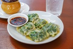 Steamed chives dumplings and Spicy sauce on a white plate stock photography