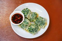Steamed chives dumplings and Spicy sauce on a white plate stock images