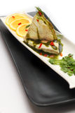 Steamed cod fish topped with special sauce Royalty Free Stock Photography