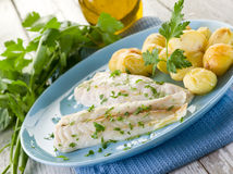 Steamed cod with parsley Royalty Free Stock Images