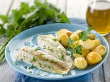 Steamed cod with parsley and potatoes Stock Photo