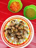 Steamed conch with sauces. Vietnamese street food of steamed conch with dipping sauces Stock Photography