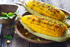 Steamed corn with ingredient herb on wooden plate Royalty Free Stock Photo