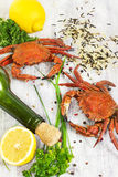 Steamed crab with fresh lemon and aromatic herbs on wooden backg Stock Photography