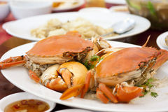 Steamed crabs. Steamed sea crabs with lime sweet fish sauce Stock Photos