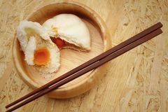 Steamed dumpling - chinese bun on brown background. Royalty Free Stock Image