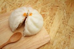 Steamed dumpling - chinese bun on brown background. Stock Photos