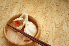 Steamed dumpling - chinese bun on brown background. Royalty Free Stock Photo