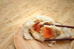 Steamed dumpling - chinese bun on brown background. Royalty Free Stock Photos