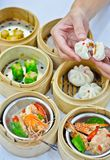 Steamed dumpling and dimsum with hand Stock Photo