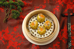Steamed dumpling on table in chinese restaurant. Yumcha. dim sum in bamboo steamer.Crab roe shao-mai Stock Photography