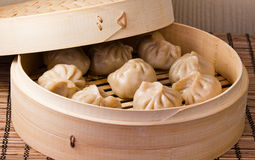 Steamed dumplings. In a bamboo steamer Royalty Free Stock Photo