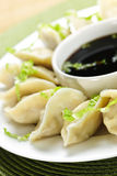 Steamed dumplings and soy sauce Stock Images