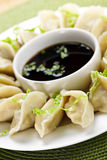 Steamed dumplings and soy sauce Royalty Free Stock Images