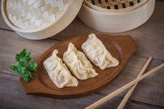 Steamed dumplings on wooden plate Royalty Free Stock Image