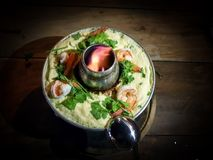 Steamed Egg Kai Thoon boiled in fire pot with Shrimp and Coriander on a wood Royalty Free Stock Images