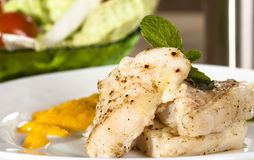 Steamed fish. With ginger sauce stock photography