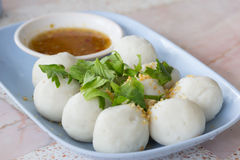 Steamed fish balls with spicy dip Stock Photo