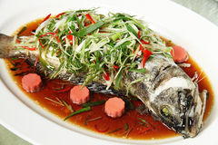 Steamed fish. Chinese style steamed fish in soy sauce Stock Photo
