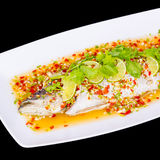 Steamed fish, Chinese style steamed fish in spicy sauce Royalty Free Stock Photos