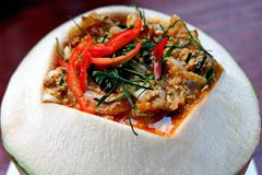 Steamed Fish with Curry Paste in Coconut Shell stock images
