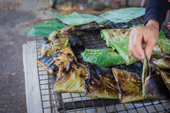 Steamed fish with curry paste. Is delicious with hand blur motion Stock Photos