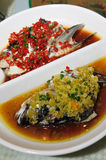 Steamed Fish head with diced hot red peppers Royalty Free Stock Photo