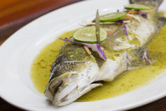 Steamed fish in lemon sauce Stock Photography