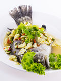 Steamed fish with lemon on white dish Stock Images