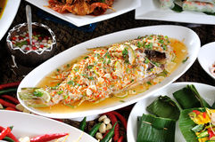 Steamed  fish in lime dressing. Steamed basa fish in lime dressing Royalty Free Stock Photography
