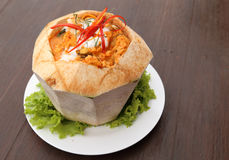 Steamed fish and seafood with curry paste in coconut Royalty Free Stock Photography