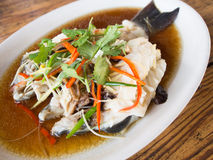 Steamed fish with soy sauce Stock Image