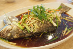 Steamed Fish with soya sauce. Steamed Fish with soy sauce with chili and ginger Royalty Free Stock Photo