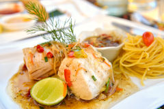 Steamed fish with spicy ginger sauce Stock Photos