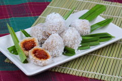 Steamed flour with minced coconut wrap sweet mashed coconut . Royalty Free Stock Photography