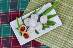 Steamed flour with minced coconut wrap sweet mashed coconut . Stock Photography