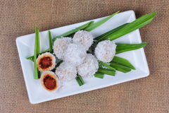 Steamed flour with minced coconut wrap sweet mashed coconut . Royalty Free Stock Photo