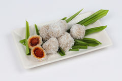 Steamed flour with minced coconut wrap sweet mashed coconut Royalty Free Stock Photography