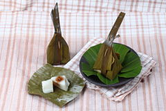 Steamed flour wrap sweet mashed coconut as Khanom Sai Sii Stock Images