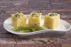 Steamed Gram Flour Snack. Gujarati Khaman Dhokla or Steamed Gram Flour Snack royalty free stock image