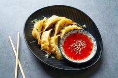 Steamed gyozas teriyaki sauce and sesame Stock Image