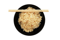 Steamed healthy unpolished brown rice in black bowl and chopstic Stock Image