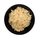 Steamed healthy unpolished brown rice in black bowl isolated on Stock Photos