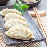 Steamed Korean dumplings Mandu with chicken meat and vegetables. On black plate, square format Royalty Free Stock Photos
