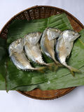 Steamed mackerel fish. In bamboo basket with banana leaf Stock Photography