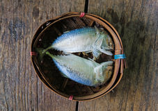 Steamed Mackerel fish. On bamboo wicker basket Royalty Free Stock Photo